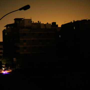 Image: A power cut is conducted at Elmarag City in Maadi, Cairo