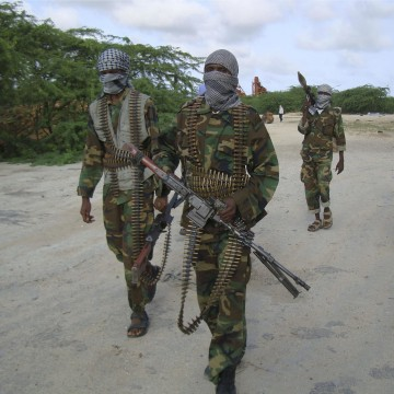 Image: Hard-line Islamist Al Shabab fighters conduct military exercise in northern Mogadishu's Suqaholaha neighborhood, Somalia