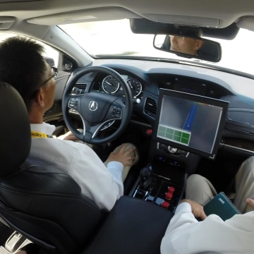 Image: The driver of a prototype Acura RLX sedan places his hands on his knees during a driving demonstration in Detroit, Tuesday, Sept. 9, 2014.