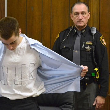 """Image: Lane shows his t-shirt with the words """"Killer"""" at his sentencing in Cleveland"""