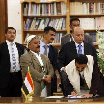 Image: Mehdi Al-Mashat, representative of Houthi leader Abdul-Malik al-Houthi, signs an agreement in Sanaa