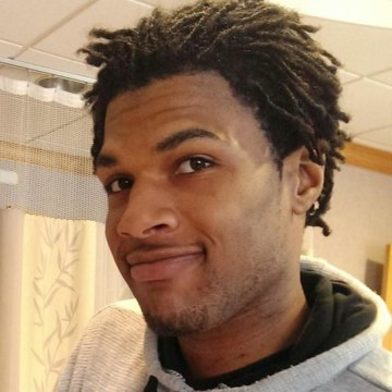 Image: John Crawford III, who was shot and killed by a police officer on the evening of Aug. 5