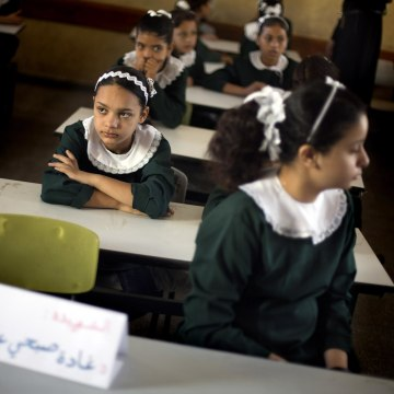 Image: Palestinian girls sit in a classroom in Gaza City on Sept. 14