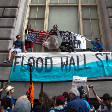 Image: Flood Wall Street march and rally in New York