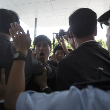 Image: Police stop student protesters as they rush to meet Chief Executive Leung Chun-ying at government headquarters in Hong Kong