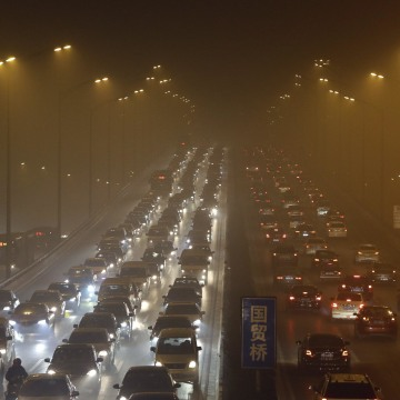 Image: File photo shows vehicles driving on the Third Ring Road on a very hazy winter day in Beijing