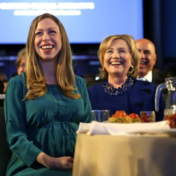 Image: Former U.S. Secretary of State Hillary Clinton and her daughter Chelsea Clinton listen as U.S. President Barack Obama speaks at the Clinton Global Initiative in New York