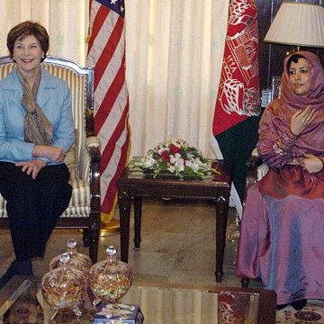 U.S. First Lady talks with Afghan First Lady during a meeting at the Presidential Palace in Kabul