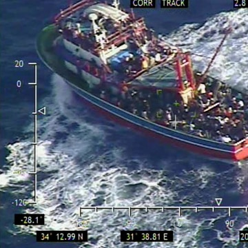 Image: A small vessel loaded with 353 people who are believed to be refugees fleeing Syria