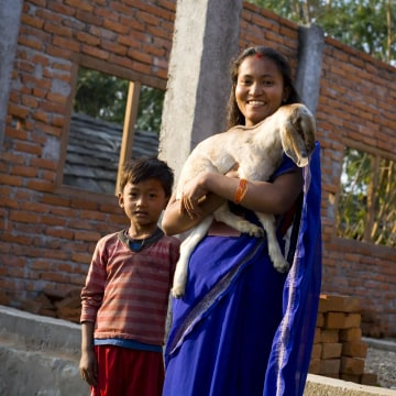 Image: Mandira Bote, a beneficiary of the Heifer Goat Project, pictured with her seven-year-old son Sanam Bote in Sarlahi, Nepal.
