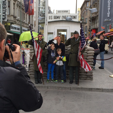 Image: Tourists at the former Checkpoint Charlie border crossing in Berlin