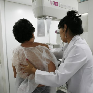 Image: A woman undergoes a free mammogram inside Peru's first mobile unit for breast cancer detection, in Lima