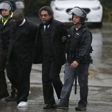 Image: Activist Cornel West is detained by police during a protest at the Ferguson Police Department in Ferguson