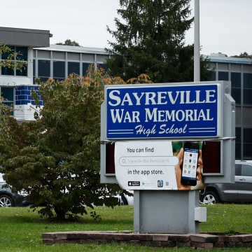 Image: A Sayreville War Memorial High School sign stands in front of the school