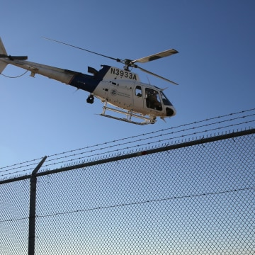 Image: A U.S. Office of Air and Marine (OAM) helicopter patrols near the U.S.-Mexico border