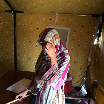 18-year-old teacher Zainab in a tent used as a classroom in the Bakakhel IDP camp.