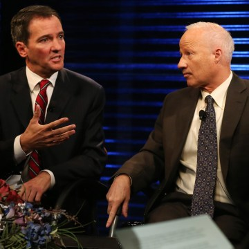 Democratic challenger Andrew Romanoff, left, makes point as his opponent, Republican incumbent Mike Coffman.