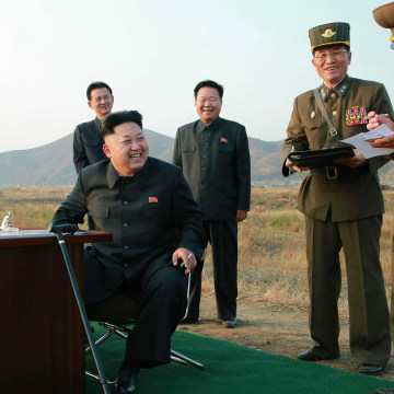 Image: North Korean leader Kim Jong Un sits on a chair as he guides a flight drill for the inspection of airmen of the Korean People's Army Air and Anti-Air Force