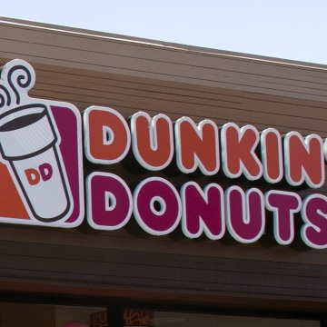Image: The signage is pictured at a newly opened Dunkin' Donuts store in Santa Monica