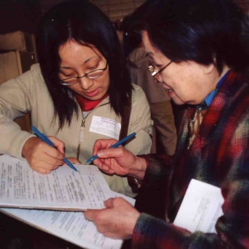 Volunteers from Asian American Legal Defense and Education Fund (AALDEF) conduct exit polling in 2000.