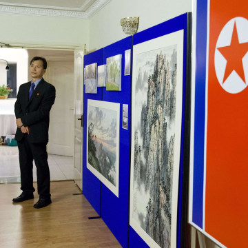 Image: A staff member supervises during a photocall at the North Korean Embassy in London