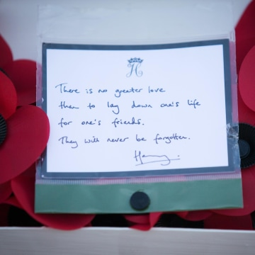 Image: A message on a poppy wreath laid by Prince Harry