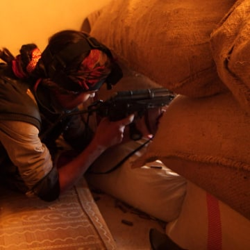 A female Kurdish sniper fighting against ISIS in the Syrian town of Kobane.