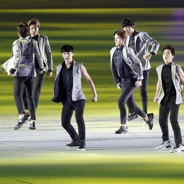 Image: K-pop boy band EXO perform during the Opening Ceremony of the 17th Asian Games in Incheon