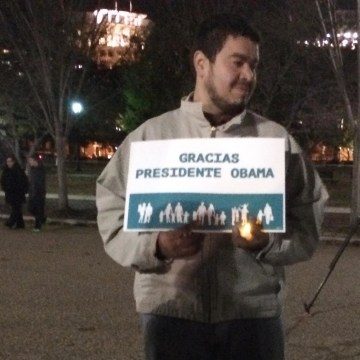 "Image: A demonstrator holds a sign reading ""Thank you President Obama"" outside the White House"