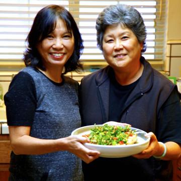 Priscilla Ouchida (left) and Joanne Morita (right) prepare Grandma Bette's Watercress Tofu Salad.
