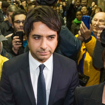 Image: Celebrity radio host Ghomeshi leaves court after getting bail on multiple counts of sexual assault in Toronto