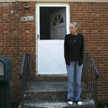 Image: Donna Cox stands outside of her home in Cleveland, OH