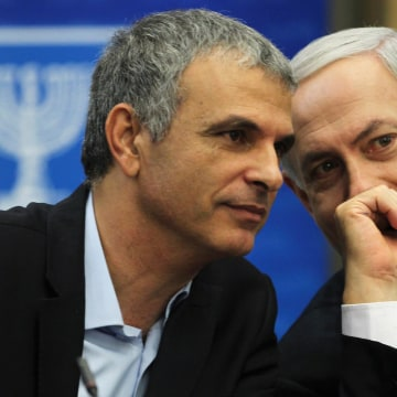 Kahlon, Israel's Communications and Social Welfare Minister speaks with Prime Minister Netanyahu during a Likud party meeting in Jerusalem