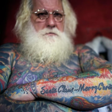 Image: Vitor Martins displays one of his Christmas tattoos inside his house near Sao Paulo