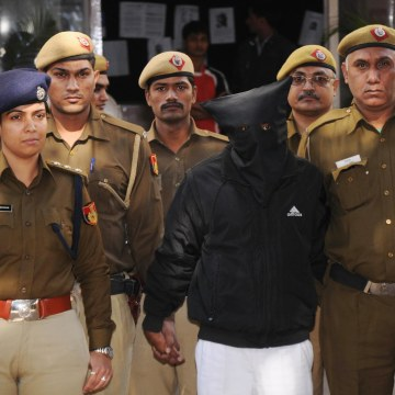 Image: Uber taxi driver accused of raping is taken to a court in New Delhi.