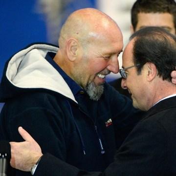 Image: Serge Lazarevic, left, France's last remaining hostage, embraces French President Francois Hollande