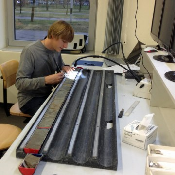 Image: University of Utah geochemist Gabriel Bowen works on Wyoming sediment cores