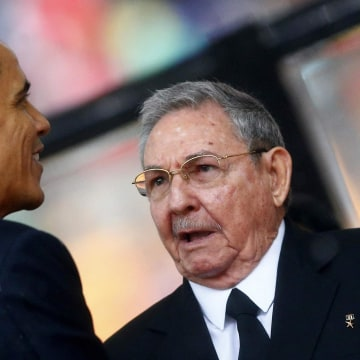 Image: File photo of U.S. President Obama greeting Cuban President Castro at the memorial service for Mandela in Johannesburg