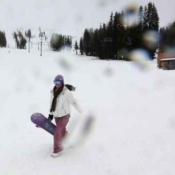 Image: Katie McGlothern, 25, leaves the slopes as rain begins to fall at the Boreal Mountain Ski Resort