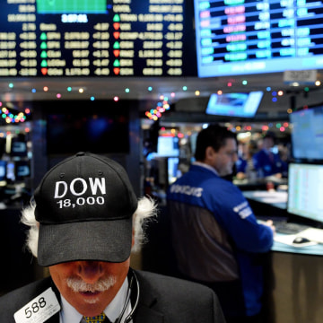Image: Dow Jones average closes over 18,000 at New York Stock Exchange