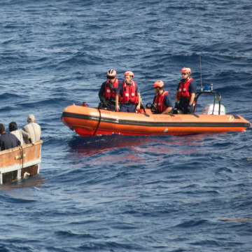 Image: A US Coast guard supplied image of men rescued from a boat off of Florida.
