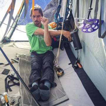 Image: Kevin Jorgeson streches while hanging off of Dawn Wall