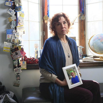 Image: Nancy Bird poses in her husband's office at their home almost one year after he disappeared from their home in suburban New Jersey. David Bird, 56, left the home for a short walk without his cellphone or medications.