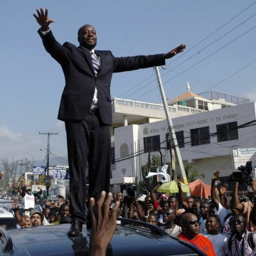 Image: Wyclef Jean greeting the crowd before officially registering as a presidential candidate in Port-au-Prince