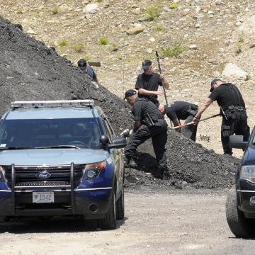 Image: Massachusetts State Police dig for evidence an industrial park in North Attleborough, Mass. on June 20, 2013
