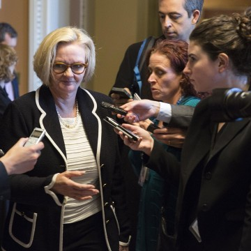 Image: Senator Claire McCaskill (D-MO) walks after leadership elections for the 114th Congress