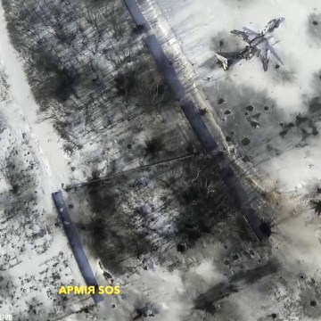 Image: Still image taken from handout aerial footage shot by drone shows outline of an airplane in the snow at Sergey Prokofiev International Airport damaged by shelling during fighting between pro-Russian separatists and Ukrainian government forces, in D