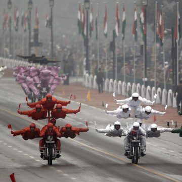 """Image: India's BSF """"Daredevils"""" motorcycle riders perform stunts as they take part during the Republic Day parade in New Delhi"""