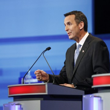 Tim Pawlenty speaks beside Michele Bachmann during the Republican presidential debate in Ames
