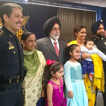 Deputy Sandeep Singh Dhaliwal with family and Sheriff Adrian Garcia (R-L).
